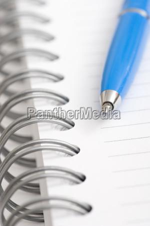 blue pen on notebook