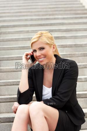 businesswoman on escalator