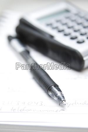 pen calculator and notebook