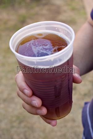 fresh beer in hand