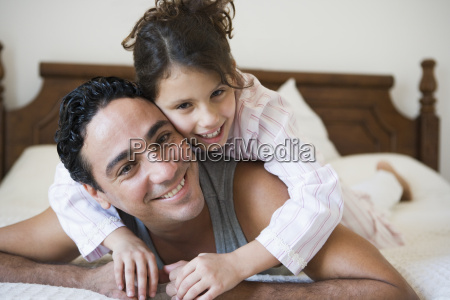 man and young girl relaxing on