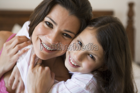 woman and young girl in bedroom