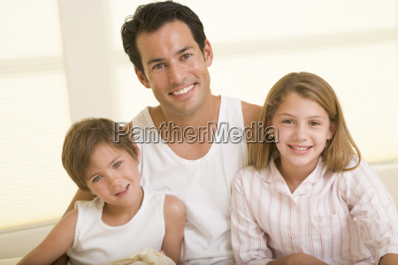 man with two young children sitting