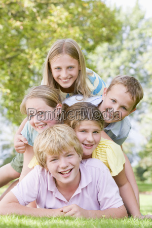 five young friends piled on each
