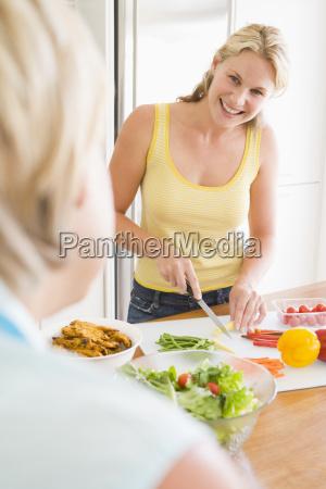 woman talking to friend while preparing