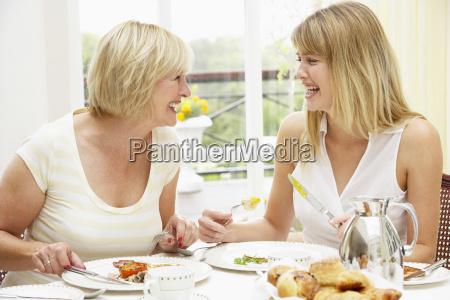 two women enjoying hotel breakfast