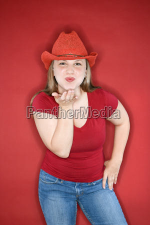 young woman blowing kiss