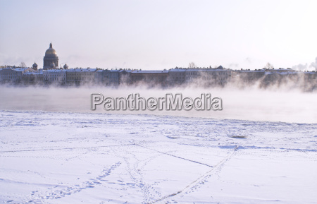 fogged neva river and st isaac