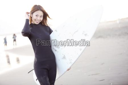japanese surfer in enoshima beach