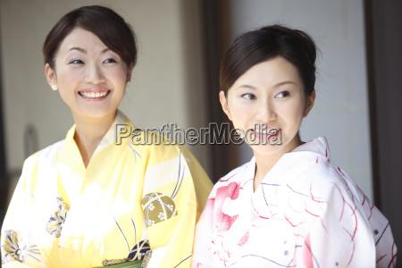 japanese women putting on a yukata