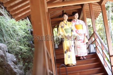 japanese woman putting on a yukata