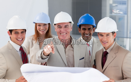 a group of smiling architects studying
