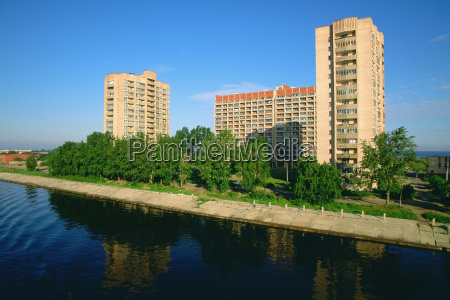 buildings along a river river neva