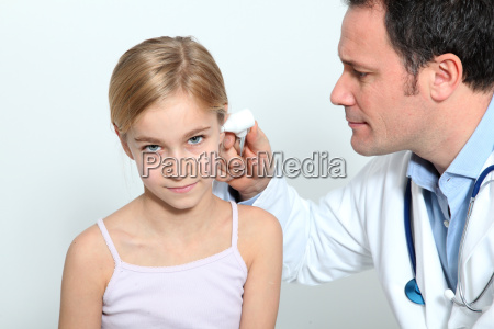 doctor doing child medical check up
