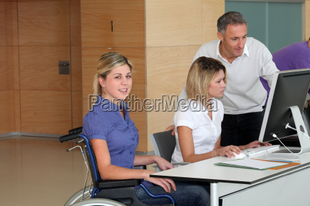 woman in wheelchair working in the