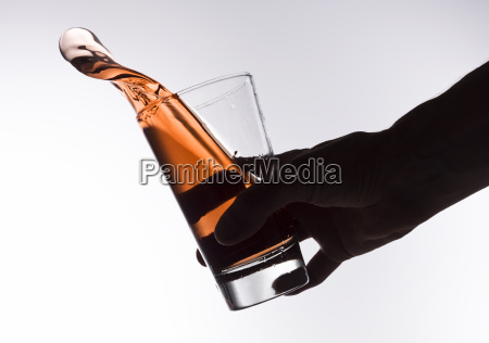 silhouette of an hand holding a