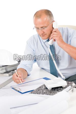 professional architect work on blueprint on