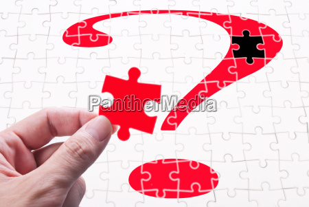 question mark hand and puzzle game