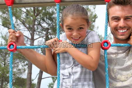 young girl on a climbing frame