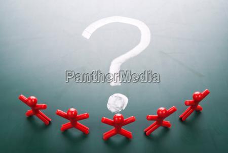 business team face question mark