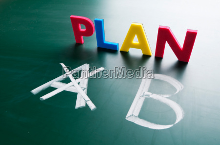 crossing out plan a and writing