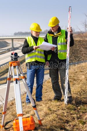 geodesist read plans on construction site