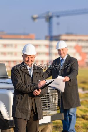 architect man make notes on construction