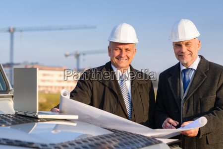 architect developer hold construction plan