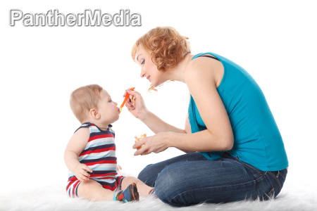 young mother feeds her baby