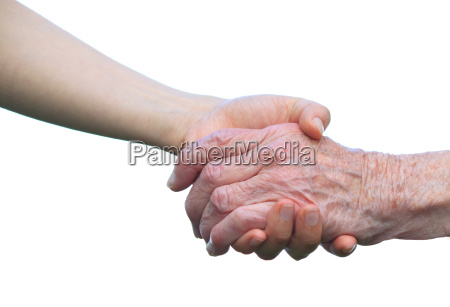 senior and young hands