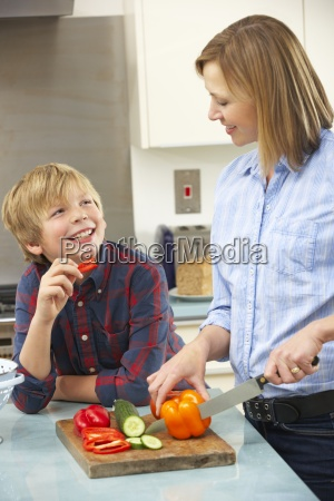 mother and son preparing food in