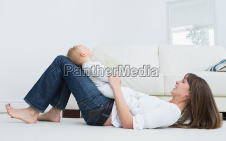 mother lying on the floor with