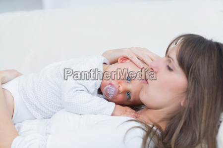 baby lying on his mother in
