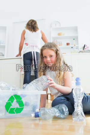 daughter sorting plastics while her mother