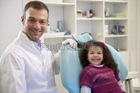 portrait of child and dentist in