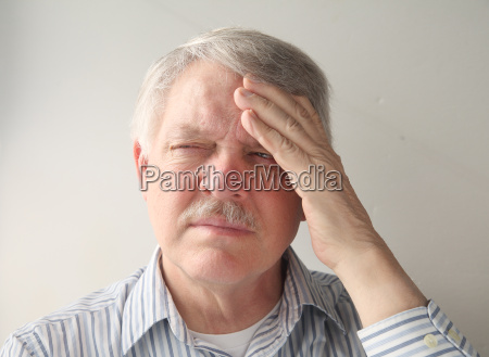 older man with head pain