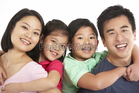 studio shot of chinese family