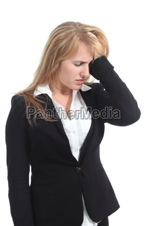 stressed businesswoman with her hand in