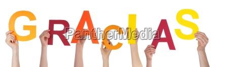 hands holding a colorful gracias
