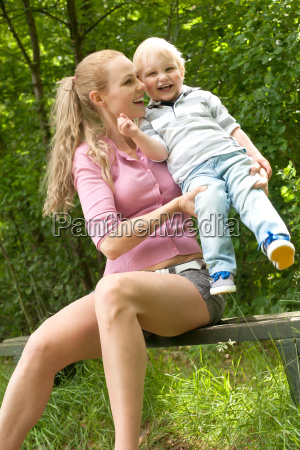 smiling child and his mother