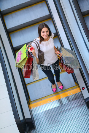happy young woman in a shopping