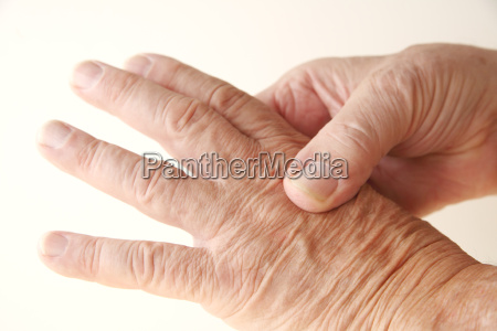 aching knuckle on older man