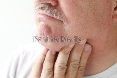 closeup of man with sore throat