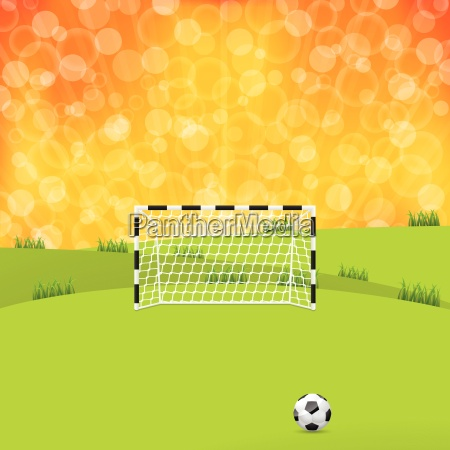 soccer ball and gate with sunset