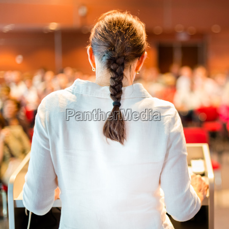 female academic professor lecturing at the