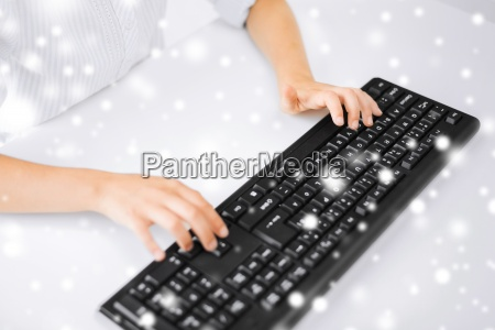 student girls hands typing on keyboard