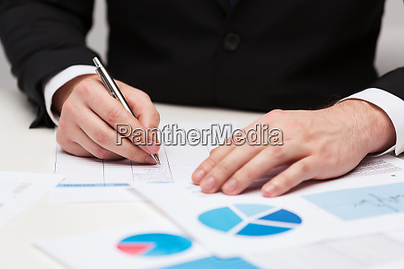 close up of businessman with papers