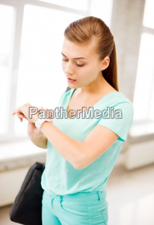 surprised student girl looking at wristwatch