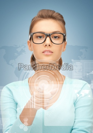 businesswoman pointing at virtual screen