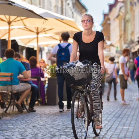 woman riding bicycle in city center